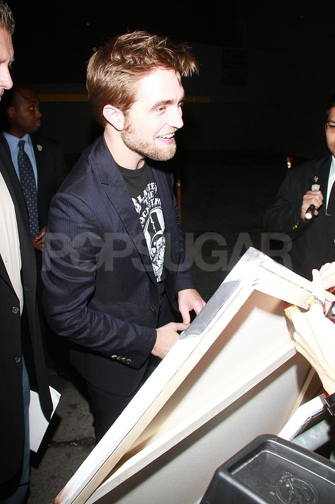 Robert Pattinson laughed with his fans.