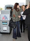 Ashley Greene talked to friends at LAX.