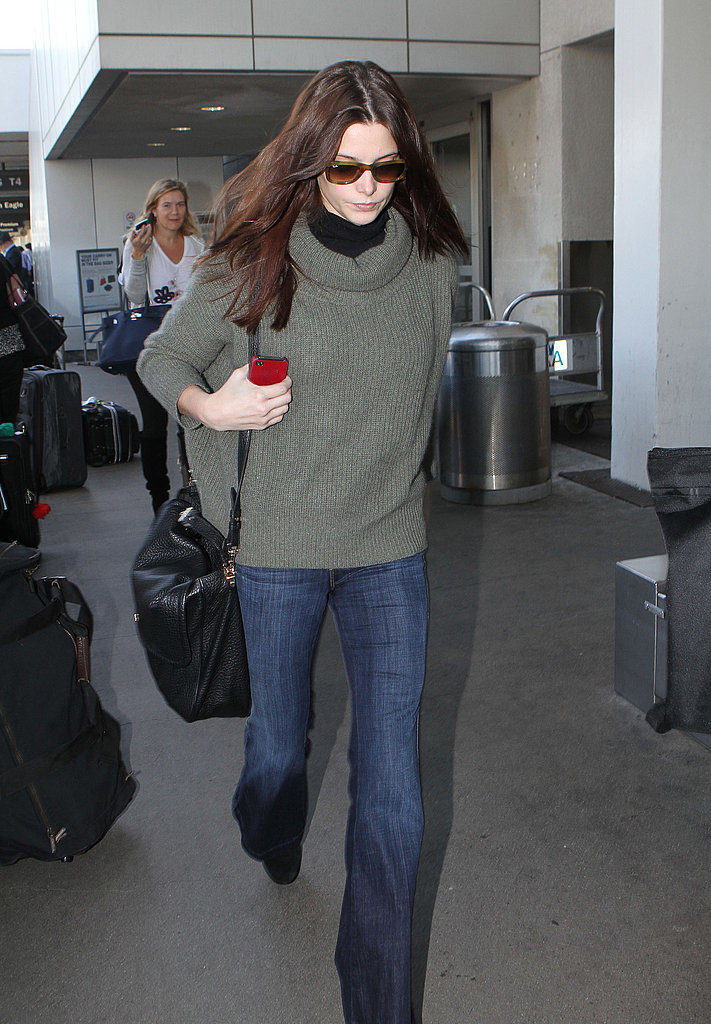 Ashley Greene toted her carry-on bag.