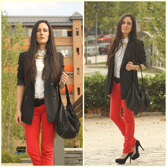 Red pants and a gold collar necklace drive this look home.  Photo courtesy of Lookbook.nu