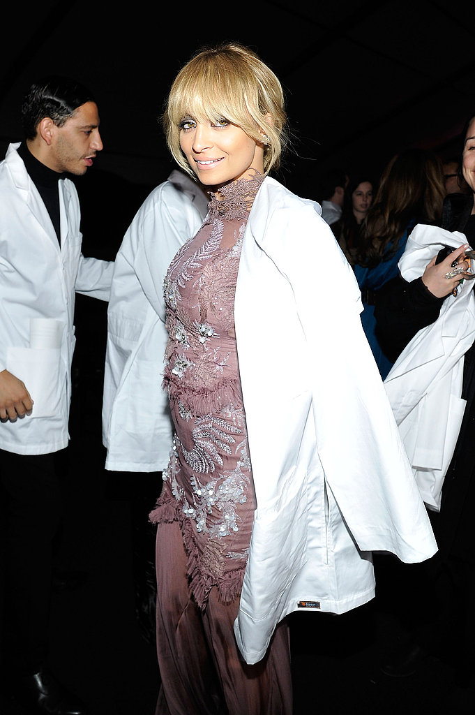 Nicole Richie threw a lab coat over her Julien MacDonald gown.