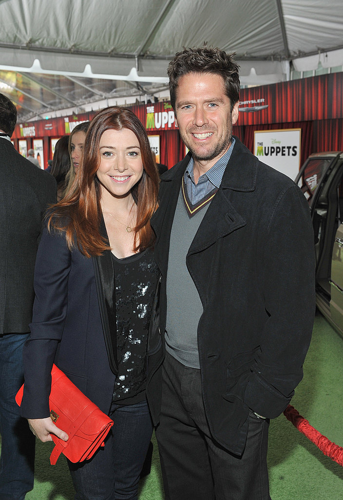 Alyson Hannigan and Alexis Denisof walked the green carpet together.