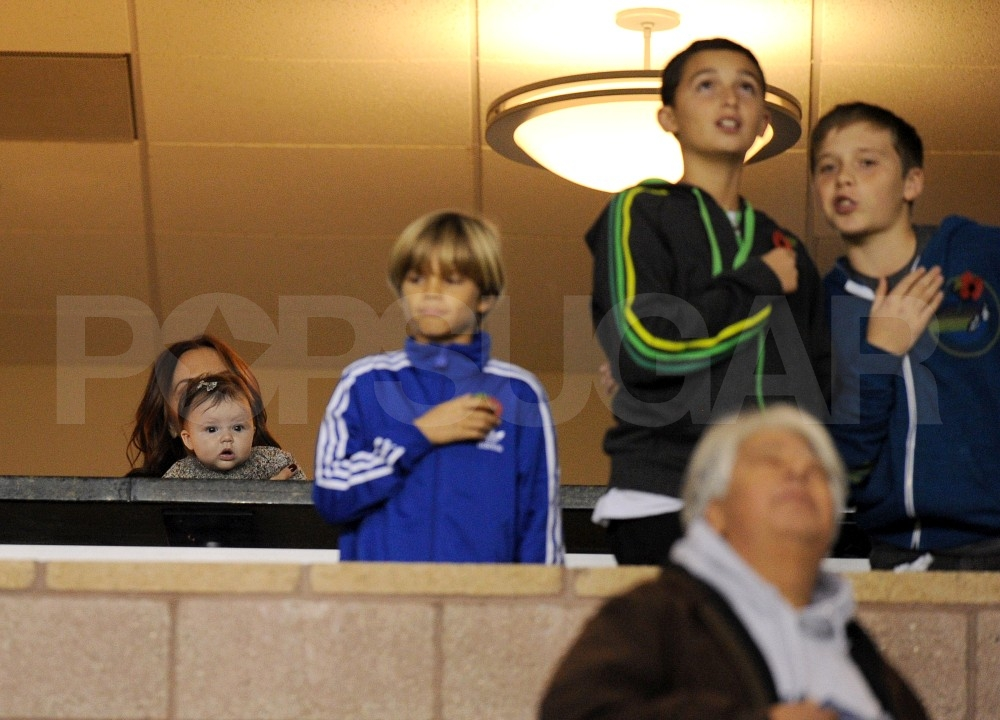 Victoria and Harper Beckham sat a row behind Romeo and Brooklyn Beckham and their friend.
