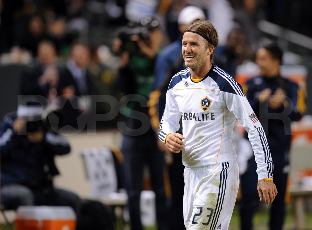 David Beckham was happy on the field.