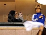 Harper Beckham was in awe of the soccer scene while mom Victoria and brother Romeo Beckham watched the game.