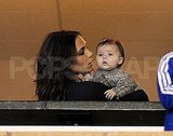 Victoria Beckham held baby Harper at David's game.