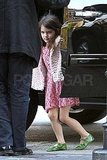 Suri Cruise kept warm in a pink jacket.