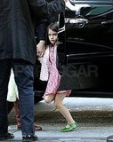 Suri Cruise held hands with her nanny.