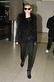 Nicole Richie walking through LAX in a fur vest.