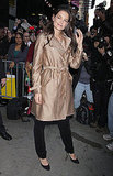 Katie Holmes kept warm in a metallic trench.