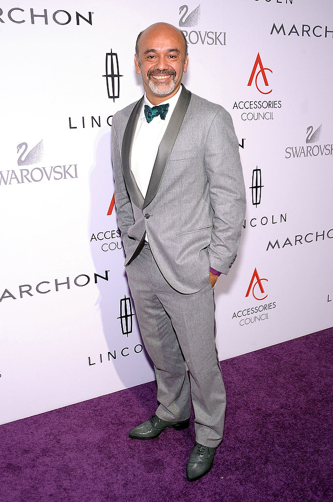 Christian Louboutin in a grey suit at the 15th annual ACE Awards.