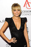 Nicole Richie in a sleek black dress.