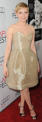Michelle Williams in Gold Oscar de la Renta With Strappy Jimmy Choo Sandals