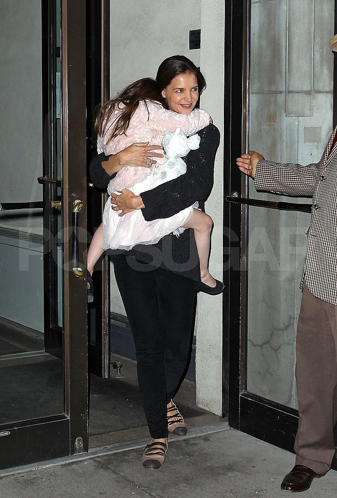 Katie Holmes carried Suri Cruise out for a shopping trip.