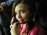 Miranda Kerr chatted on the phone while getting ready for the Victoria's Secret Fashion Show.