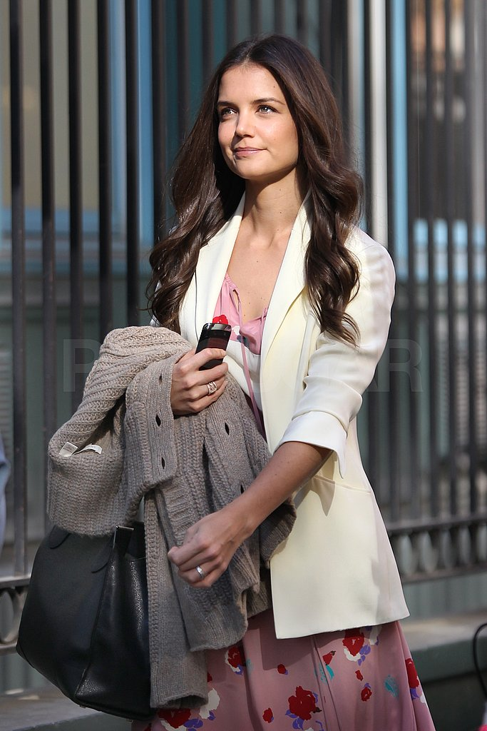 Katie Holmes carried her phone and black bag arriving at her latest interview.