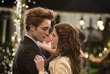 Edward and Bella share a magical moment at prom, although they're not your typical high school students.