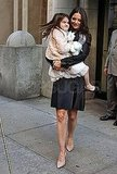 Suri carried a stuffed animal with her.