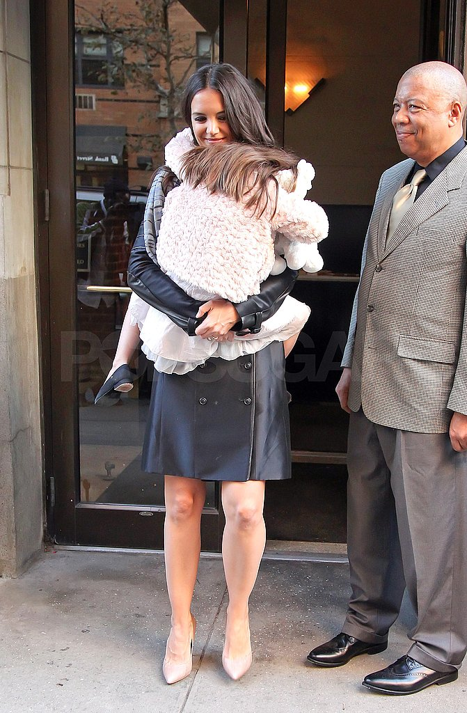 Katie and Suri left their NYC apartment earlier in the day.