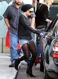 Nicole Richie in black tights and jean shorts.