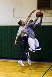 Obama blocks Reggie, who played basketball for Duke.