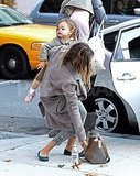 Sarah Jessica Parker balanced her daughter Tabitha and her bag.