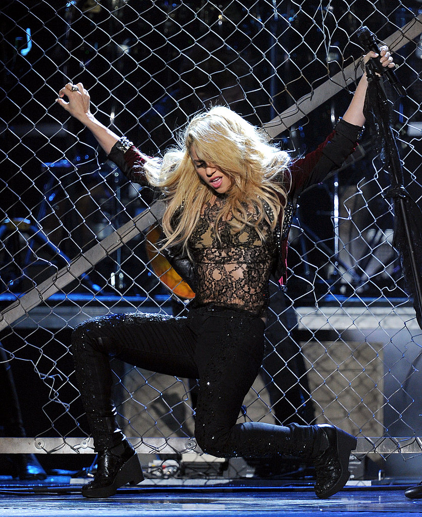 Shakira danced on a chain-link fence.