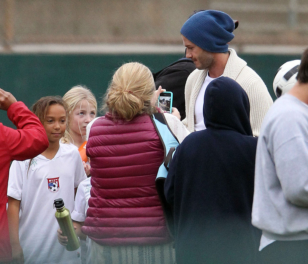 David Beckham made time for fans at his sons' soccer game.