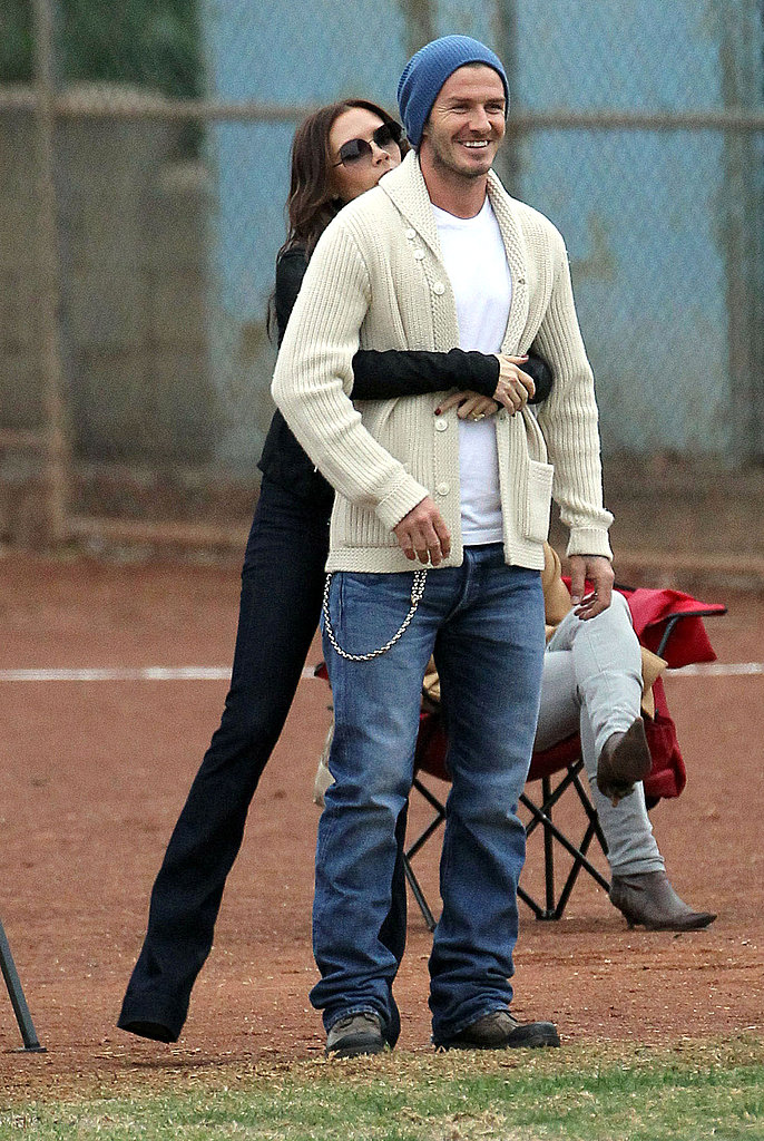 Victoria Beckham and David Beckham were not afraid to show PDA at their boys' soccer game.