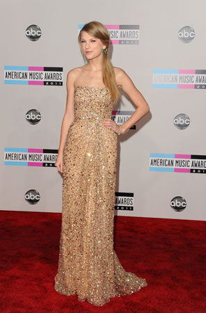 Taylor Swift, who is nominated in three categories, wore a floor-length gold dress.