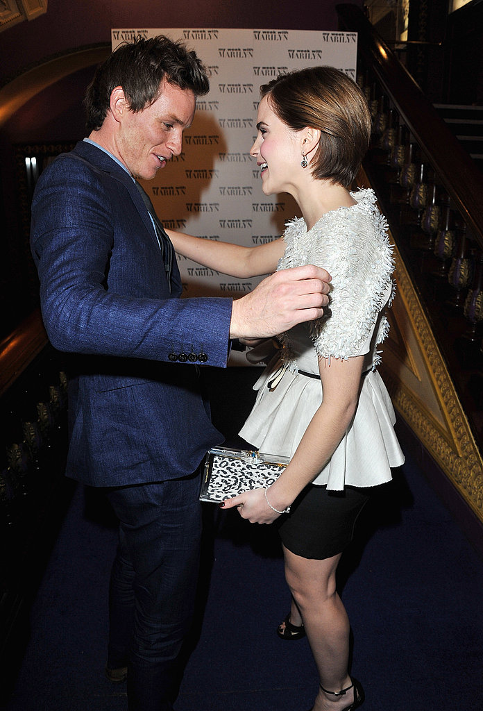 Emma Watson and Eddie Redmayne hugged and said hi at the UK premiere of My Week With Marilyn.