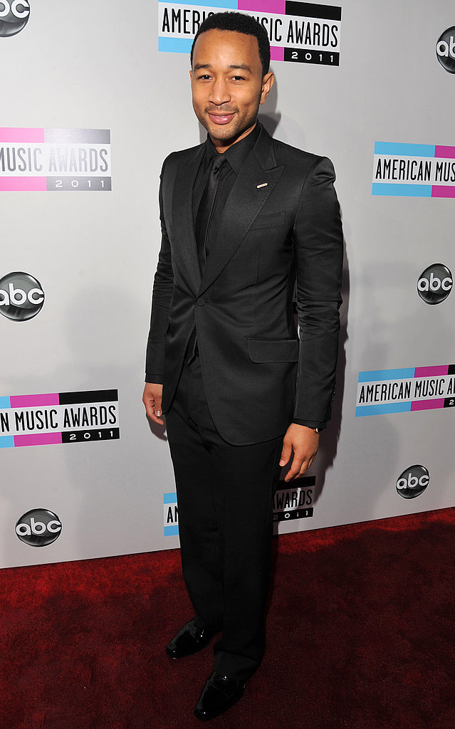 John Legend wore a chic black-on-black suit.