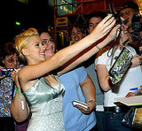 Scarlett Johansson posed for pictures with fans in 2003.