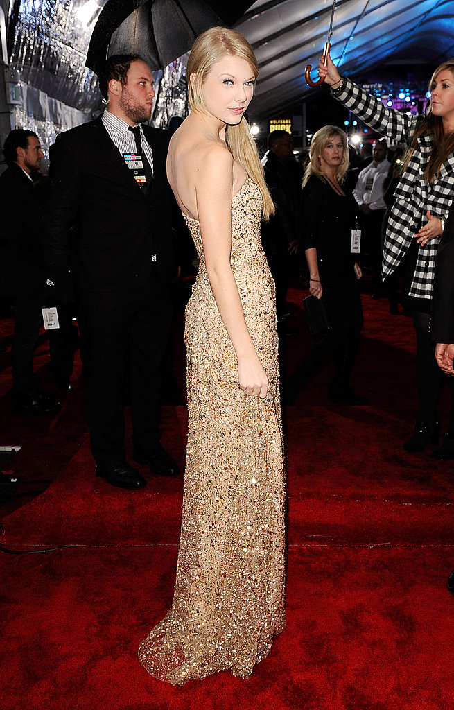 Taylor Swift wore gold to the American Music Awards.