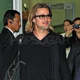Brad Pitt flashed a smile at the airport.