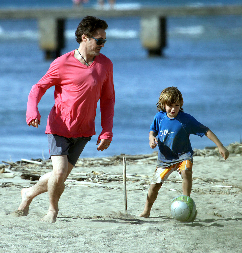 Robert Downey Jr. playing on the beach in Kauai.