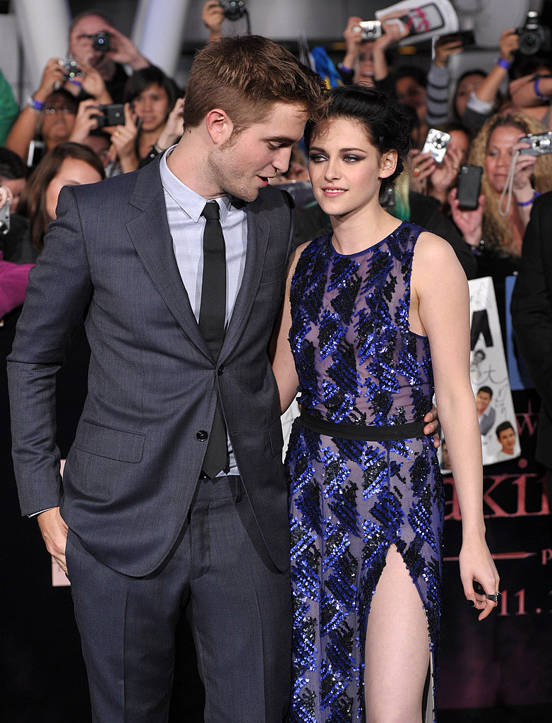 Robert and Kristen whispered to each other.
