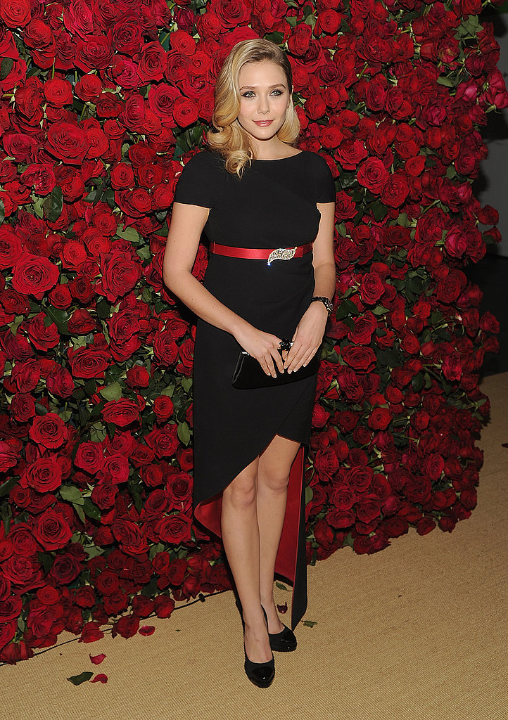 Elizabeth Olsen was pretty in red and black at an event honoring Pedro Almodovar.