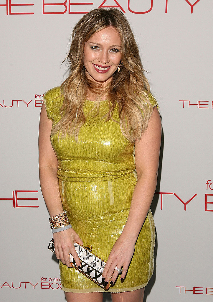Hilary posed for photos on the carpet before meeting up with her husband, Mike.