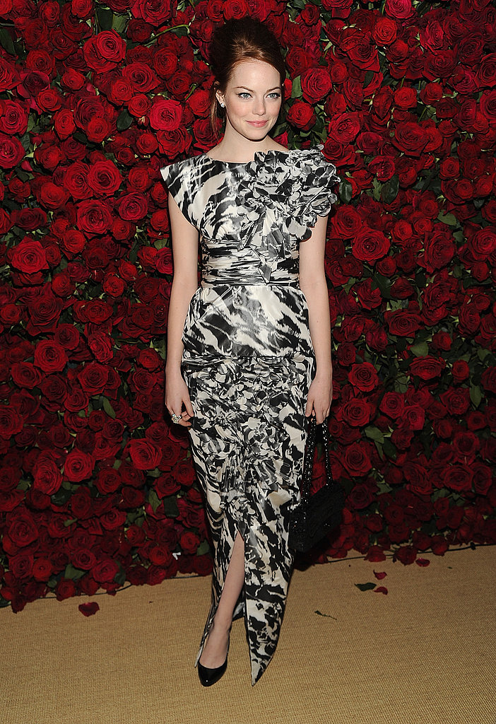 Emma Stone in a black-and-white printed dress.