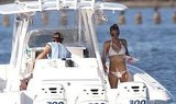 Anna Kournikova in a white bikini on a boat with Enrique Iglesias.