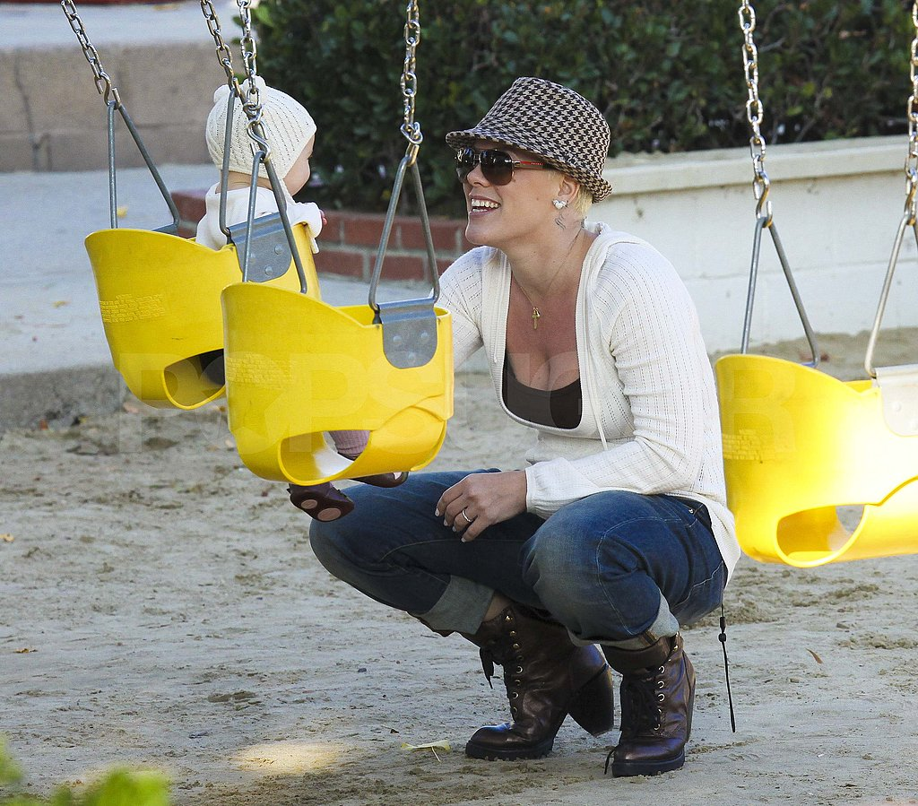 Pink and baby Willow on the swings at a Malibu park.