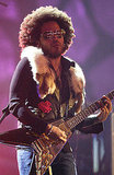 Lenny Kravitz sported an Afro while performing in 2002.