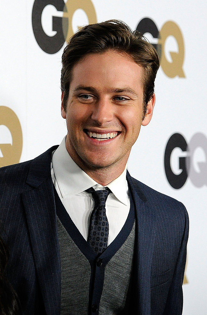 Armie Hammer wore a sweater vest under his suit jacket.