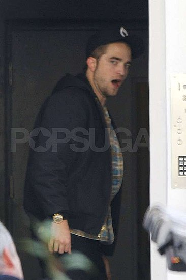 Robert Pattinson arrived back in London.