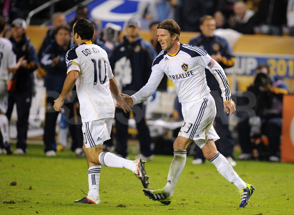 David Beckham gave a high five to his teammate.