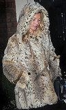 Kate Moss wearing a fur coat.