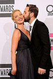 Josh Kelley and Katherine Heigl were affectionate at the American Music Awards.