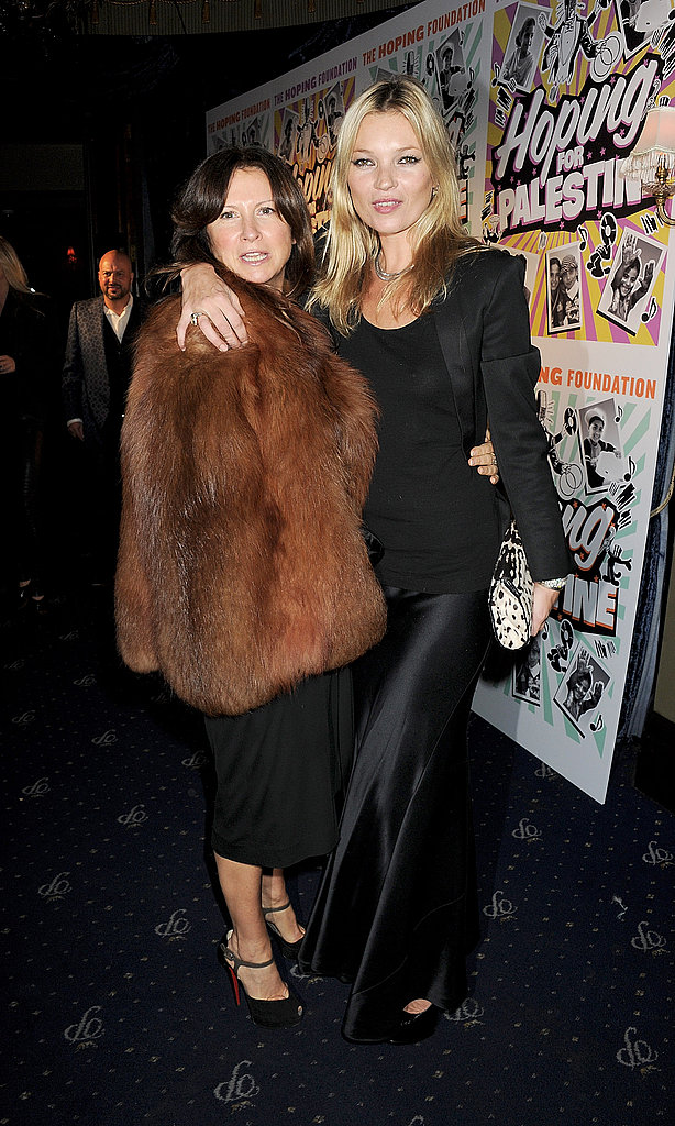 Kate Moss posing with a friend.