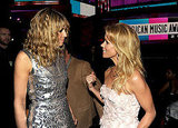 Heidi Klum and Cheryl Hines chat it out at the AMAs.